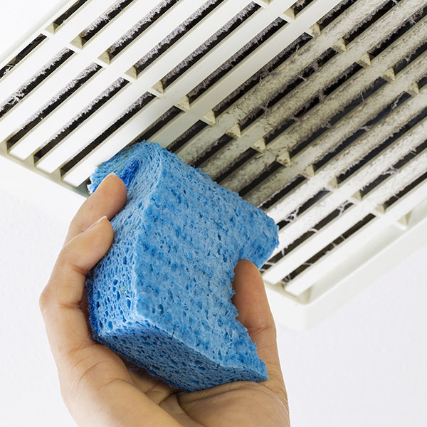 clean a bathroom extractor fan