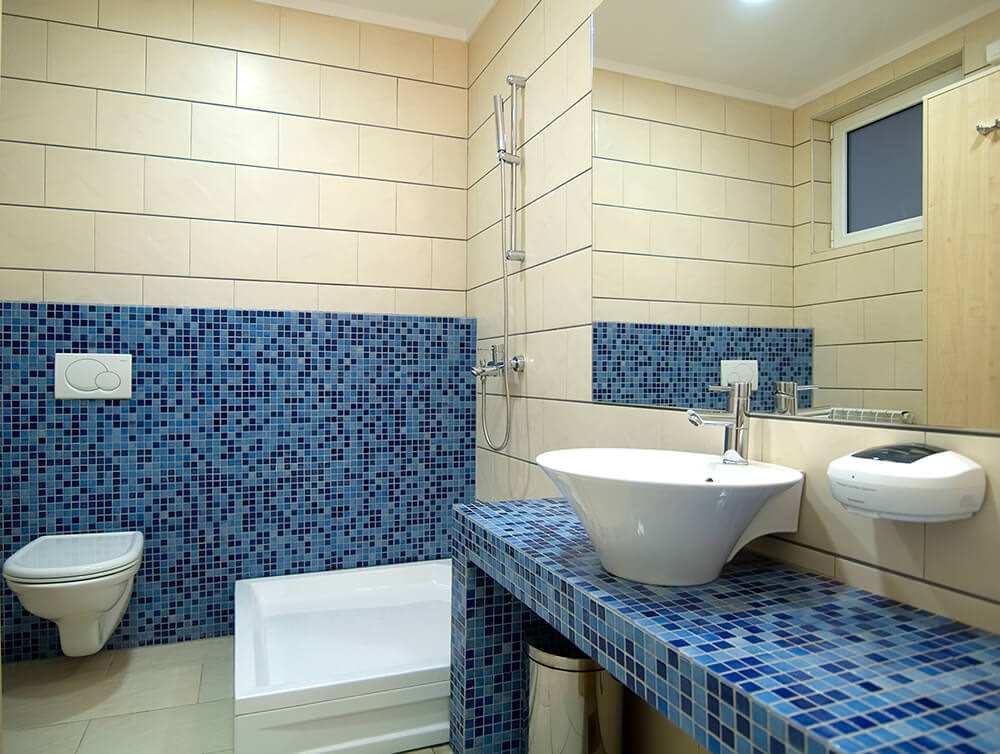 blue hexagonal tiles on the floor and wall