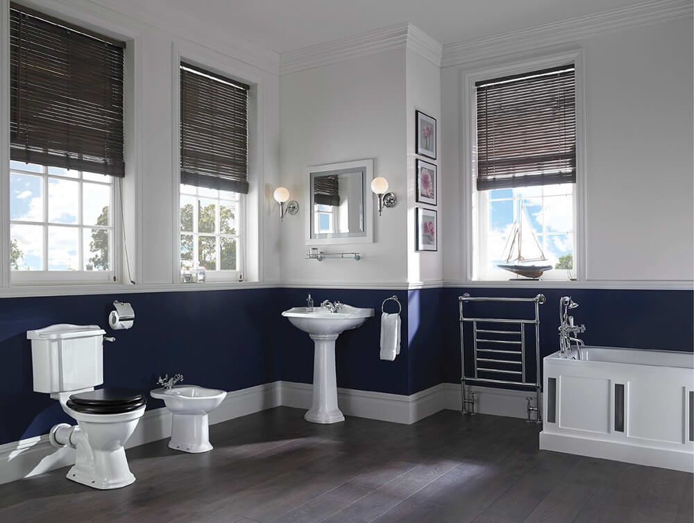 blue wallpaper and victorian style mirror