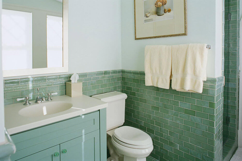 Light Green Vanity with Green Tiled Bathroom